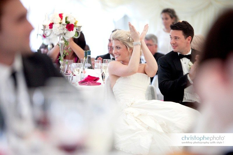 Bride clapping her hands during the wedding reception, Lanouaille France. Some of the speeches went very emotional.