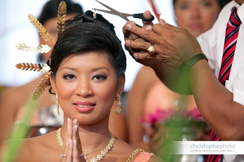 The cambodain buddhist wedding ceremony with the ritual of the hair cutting