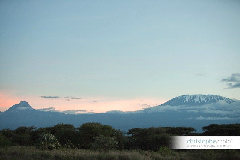 As the sun sets, the snow-capped Kilimanjaro moutain reveals itself.
