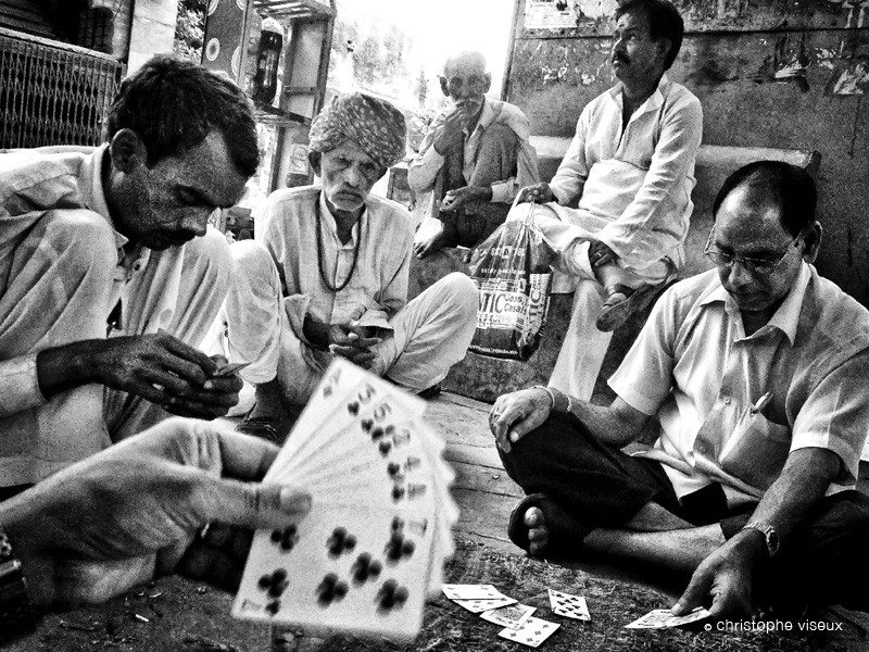 Groupe of men playing cards near Jaipur as documented by french photographer Christophe Viseux
