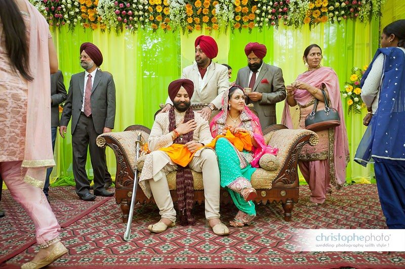 The bride and groom on the stage at the punjabi wedding. Shot by Wedding Photographer Punjab India