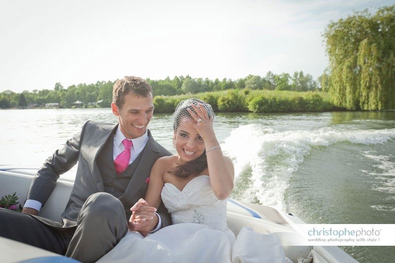 Bride and Groom going for a boat ride on the lake near Paris. As seen by Wedding Photographer Paris