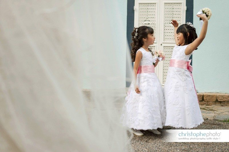 Young girls at the wedding fooling around.